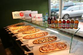 Pizza Fusion Store ViewView Of The Inside And Green Grass Designed Wall Located In Deerfield Beach Florida