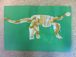 Preschool Also Made These Dinosaur Fossils First They Cut Out Multiple Pieces Of A Skeleton And Glued Them Together On The Green Paper