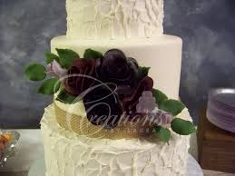White Rustic Wedding Cake Close Up Non Smooth Purple Gumpaste Roses