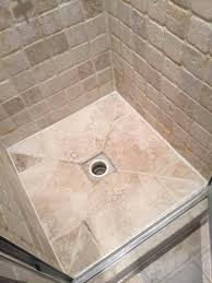 shower how can i repair cracked stones around a drain in a