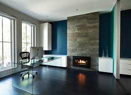 the office has been modernized with a porcelain tile fireplace