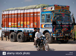 Indian Motorcyclist Rides Past Tata Trucks At Rasulpura In Sawai ... Little Set Bright Decorated Indian Trucks Stock Photo Vector Why Do Truck Drivers Decorate Their Trucks Numadic If You Have Seen The In India Teslamotors Feature This Villain Transformers 4 Iab Checks Out Volvo In Book Loads Online Trucksuvidha Twisted Indian Tampa Bay Food Polaris Introduces Multix Mini Truck Mango Chutney Toronto Horn Please The Of Powerhouse Books Cv Industry 2017 Commercial Vehicle Magazine Motorbeam Car Bike News Review Price Man Teambhp