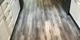 Grey Vinyl Plank Flooring In Galley Kitchen Light Gray