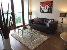 Modern Small Apartment Design Red Blue Colors Bean Bag Chairs Wooden Frames Wall Mounted Tv Black Fabric Comfy Chair Overlaping Shape Coffee Table