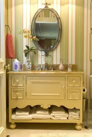 bathroom corner country bathroom vanity featuring oval