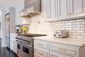 modern light gray kitchen cabinets with gold hardware