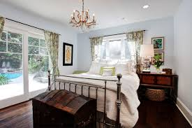 Example Of A Transitional Dark Wood Floor Bedroom Design In Los Angeles With Gray Walls