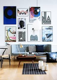 Danish Modern Sofa With Ikea Rug And Gallery Wall Im In Love The Poster Filled Idea It Would Look Especially Great On A Painted Brick