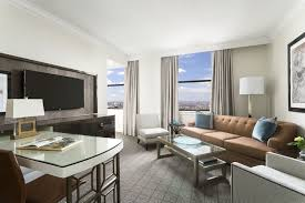Executive Suite Living Room With Sofa Bed Desk Coffee Table And Entertainment Area
