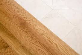 Laminate Floor Transitions To Tiles by How To Install Laminated Flooring Transition Molding Home Guides