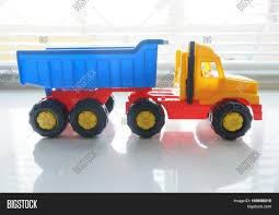 Toy Ttipper Truck, Industrial Image & Photo   Bigstock Classic Metal 187 Ho 1960 Ford F500 Dump Truck Yellow The Award Wning Hammacher Schlemmer Toy Wheel Loader Stock Photo 532090117 Shutterstock Amazoncom Small World Toys Sand Water Peekaboo American Plastic Mega Games Amloid Kids At Work With Blocks Playset Day To Moments Gigantic Tonka 2001 With Sounds 22 12 Length Hasbro Colorful On 571853446 Dump Truck Model On A Road Transporting Gravel Toy Ttipper Industrial Image Bigstock