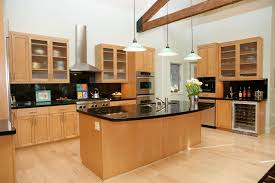 modern kitchen with granite and light maple cabinets
