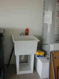 Plastic Utility Sink With Drainboard by Installing A Laundry Sink Befon For
