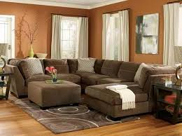 Brown theme sectional living room ideas with hardwood flooring