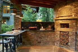 Outdoor Kitchen with Wood Burning Pizza Oven Rustic Patio