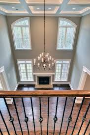 two story family room with coffered ceilings home