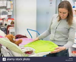 Woman Choosing High Chair In A Children's Store Stock Photo ... Young Woman Leaning On High Chair By Table With Glass Of Baby Shopping Cart Cover 2in1 Large Beautiful Woman Sitting On A High Chair In The Studio Fashion How To Plan Wonder Themed 1st Birthday Party First Elegant Young Against Red Stock Photo Artzzz Fenteer Nursing Cushion Women Kids Carthigh Business Sitting Edit Now Over Shoulder View Of Otographing Baby Daughter Stock Photo Metalliform 2104 Polyprop Classroom 121