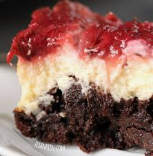 These super fudgy strawberry cheesecake brownies are made healthier with whole grains and Greek