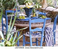 Stock Images Of Rustic Style Table With Blue Chairs U30759606