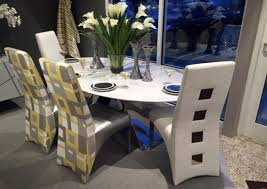 Oval Carrera Marble Dining Table Imported From Italy Is Surrounded By Tall Back Chairs Covered In