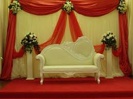 Stage Wedding Reception Decorations With Red And White Curtains Also Small Fabric Sofa Over Carpet