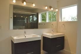 bathroom loveable rectangular mirror below three bulbs
