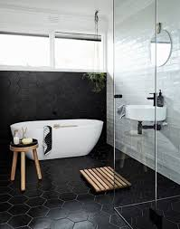 black hexagonal floor and wall tiles for bathroom with oval