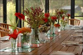 Amazing Lovely Dining Room Table Centerpieces Ideas With Several Glass Vases Flower Decoration On The