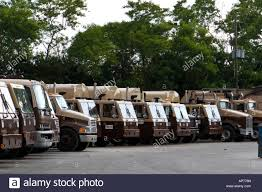 100 Trash Trucks In Action Row Of Garbage Lined Up In Sanitation Yard Stock Photo