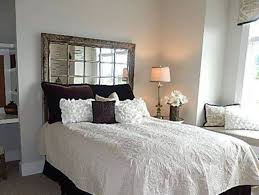 Cozy Style Bedroom Interior With Calm Mirror Headboard Design And Amazing Table Lamp Black White Cushions Also Fresh Flowers Vase Oval