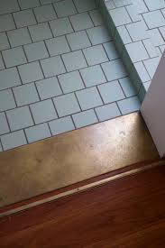 Carpet To Tile Transition Strip On Concrete by Use Of A Wide Strip Of Contrasting Tile Makes A Good Transition