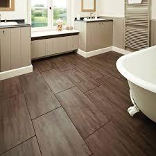 bathroom wood flooring ideas fluffy towels and cylinder wax bold
