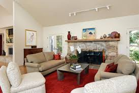 interior track lighting living room with upholstery sofa