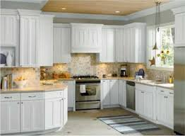 Kitchen White Wooden Cabinet And Cream Countertops Added By Beige Tile Backsplash