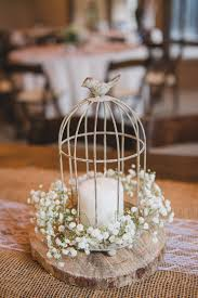 Birdcage candle babys breath rustic centerpiece on a wood round