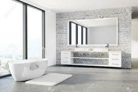 loft badezimmer interieur mit weißen und betonwänden einem betonboden einem doppelwaschbecken und einer weißen wanne spott der wiedergabe 3d