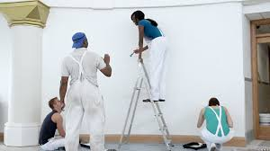 MS Women And Man Painting Wall Giving Instructions London England United