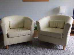 pair of ikea tullsta tub chairs in cream leather in portishead