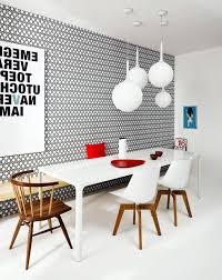 Modern Dining Room With Patterned Wallpaper And Wooden Chairs