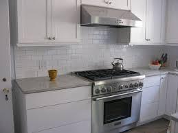 grey glass subway tile kitchen backsplash with white cabinets jpg
