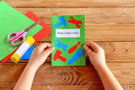 Child Holds Greeting Card In His Hands Happy Fathers Day Paper Craft Idea Project