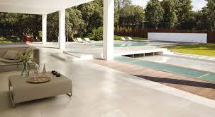 Modern indoor outdoor patio pool area with porcelain floors