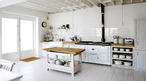 White Rustic Eat In Kitchen With Washed Floors And Cabinetry Exposed Bulb Lighting