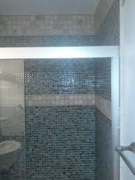 shower interior design with blue glass mosaic wall panel combined