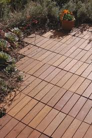 Kon Tiki Wood Deck Tiles by Bringing Wood Tiles Right To The Edge Of The Garden Some Novel