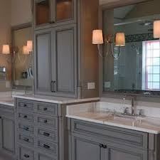 Bathroom Vanity Tower Cabinet by Master Bath Tall Cabinet In Center Of 2 Sinks Google Search
