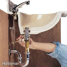 Garbage Disposal Backing Up Into Both Sinks by How To Unclog A Sink Drain With A Plunger And A Snake Family