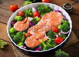 Raw Salmon Steak And Vegetables For Cooking On A Dark Wooden Background In Rustic Style