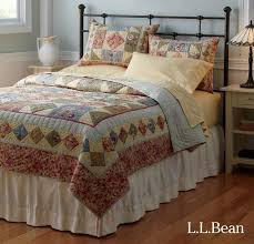 L L Bean s Lakehouse Bed and handstitched floral quilt lend a charming vintage look to any room