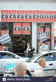 Credit Crunch Closing Down Sale For Brighton Trader With Shop Front Festooned Posters Picture By Jim Holden